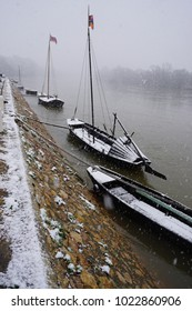 Typical wooden boats moored on the riverbank of the Loire, France on a cold winter day