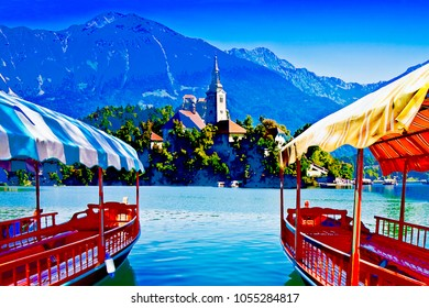 """Typical wooden boats, in slovenian called """"Pletna"""", in Bled Lake, the most famous lake in Slovenia with the island of the church (Europe - Slovenia) - Art toned image with painted image effect"""