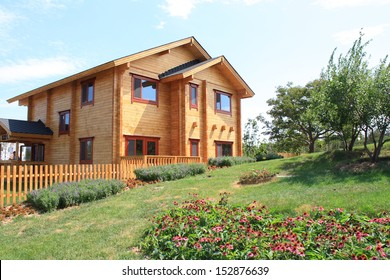 Typical wooden country house with lawn