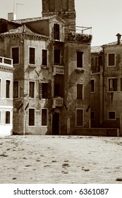 Typical, worn shabby building on an empty square in Venice Italy