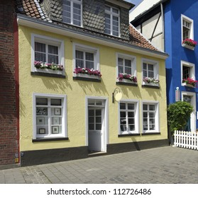 typical yellow building with flower planters in Munster, Germany