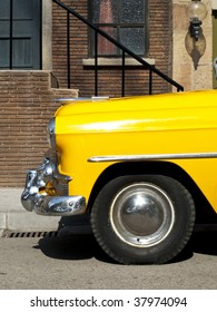 Typical yellow cab of the 50s, 60s in a old american town
