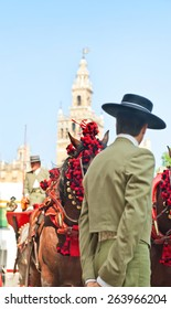 typicall image on Seville the Cathedral, La Giralda, horse and carriage and men with hats
