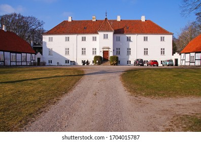 A typically classic old estate and farm in Denmark from the 18th century seen on a sunny day