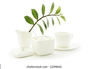 Typically English tea, white china on a white background