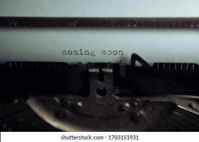 """Typing """"coming soon"""" on retro typewriter - Shutterstock ID 1703151931"""