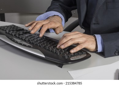Typing hands on a keyboard