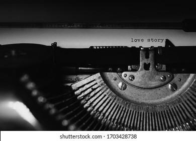 """Typing """"love story"""" on retro typewriter"""