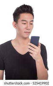 Typing text message. Smiling man with beard standing on white isolated background and holding mobile phone.