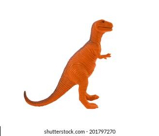 Tyrannosaur orange toy. Profile view of isolated orange plastic tyrannosaur standing on white background.