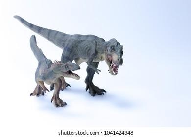 Tyrannosaurus running side by side versus Allosaurus with white background