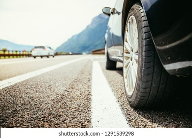 Tyre of a car on the emergency lane, breakdown on the highway. Copy space.