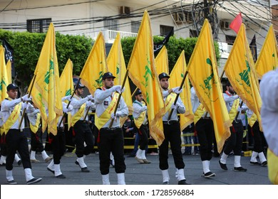 tyre city, lebanon, 24/10/2015, Ashura - islamic holy day:Yellow Hezbollah flags at the Ashura day;the remembrance ceremonies for the martyrdom of Imam Hussain; shia muslims