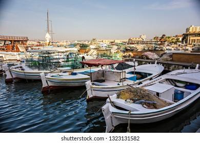TYRE, LEBANON - October 2018: Old port in Tyre (Sour), Lebanon. Fishing boats in the harbor, Tyre, Lebanon