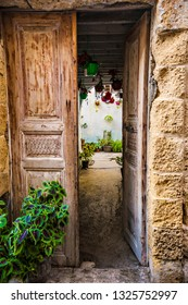 TYRE, LEBANON - October 2018: Old house entrance door in Tyre (Sour) city at sunset, Lebanon. Traditional Lebanese house