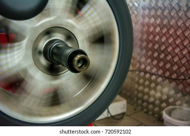 tyre spinning on the balancing machine at the tyre shop