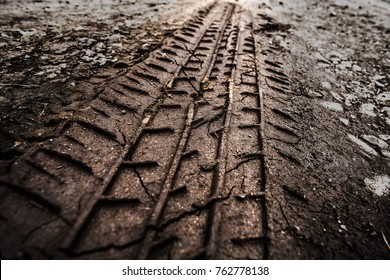 Tyre track on dirt sand or mud, retro tone, grunge tone, drive on sand, off road track