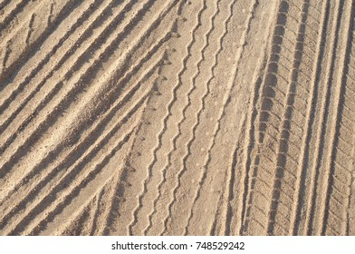 Tyre tracks on the sand beige background