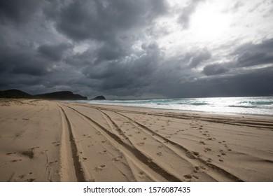 Tyre tracks on sand, Sandbar beach Australia