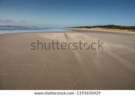 Tyre Tracks On Sandy Beach On Stock Photo (Edit Now) 1193650429