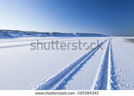 Tyre Tracks Snow On Beach Island Stock Photo (Edit Now) 569284345