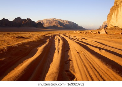 Tyre Tracks through the Sand at Sunset, Wadi Rum, Jordan