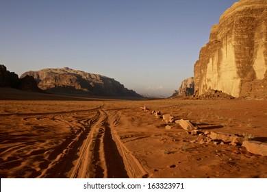 Tyre Tracks throuugh the Sand at Sunset, Wadi Rum, Jordan