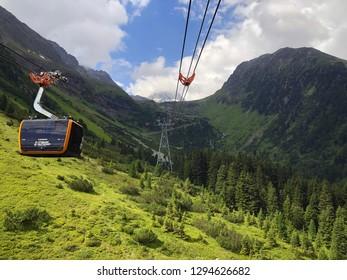 TYROL, AUSTRIA - JULY 2018 : Stubaier Gletscher gondola lift approaching station at Stubai Glacier in Tyrol, Austria on July 26, 2018.