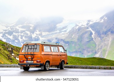 TYROL, AUSTRIA - JULY 29, 2014: Blue classic van Volkswagen Caravelle at the parking near the high Alpine mountain road.