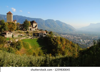 Tyrol Castle in Tirolo, South Tyrol, Italy and a view in the vally with meran. Tyrol Castle is home to the South Tyrolean Museum of Culture and Provincial History