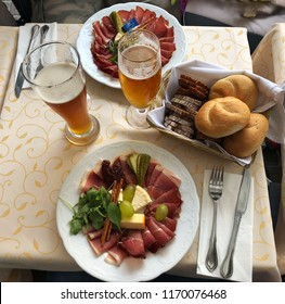 Tyrolean table with speck, cheese and beer
