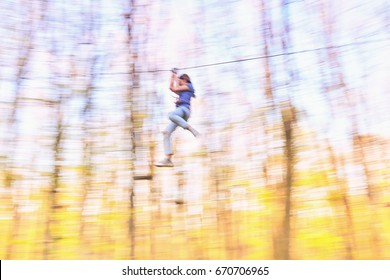 """A Tyroliana Parc Aventure in """"Eden Park"""", Bucharest. Panning photograph. Speed."""