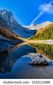 Tyrst Lake and colorful larch trees in Kananaskis, Canada