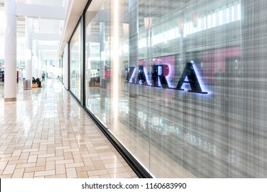 Tysons Corner, USA - January 26, 2018: Fast fashion clothing, clothes, apparel specialty store, shop Zara with sign, logo with people walking in shopping mall in Virginia
