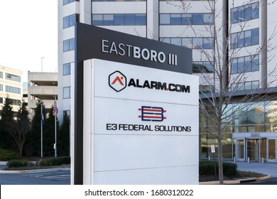 Tysons Corner, Virginia, USA- March 1, 2020: Sign Alarm.com headquarters in Tysons Corner, Virginia, USA. Alarm.com, Inc is an American technology company that provides cloud based services.