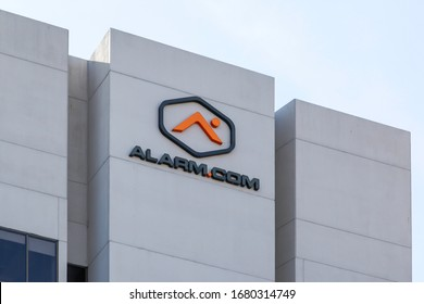 Tysons Corner, Virginia, USA- March 1, 2020: Alarm.com sign and logo on building in Tysons Corner, Virginia, USA. Alarm.com, Inc is an American technology company that provides cloud based services.