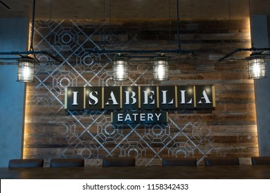Tysons - McLean, Virginia, USA - August, 11, 2018: Isabella Eatery big stand presentation with logo at Tysons Galleria Mall II.