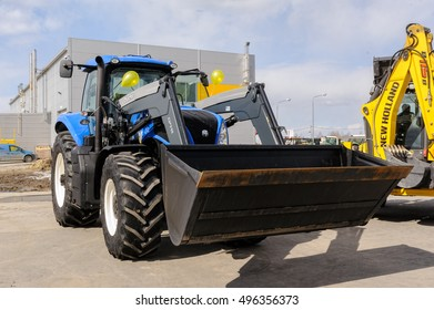 Tyumen, Russia - April 04. 2014: IV Tyumen specialized exhibition Agricultural Machinery and Equipment. Plow tractor on special dirt range