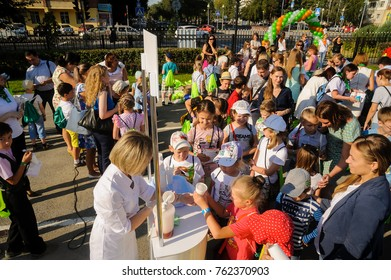 Tyumen, Russia - August 26, 2016: Open Day of Sberbank for children. Point of distribution of oxygen cocktails