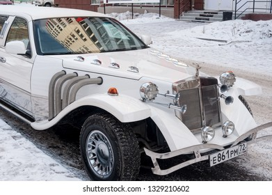 Tyumen, Russia - January 29, 2012: Vintage Wedding Car Decorated with Flowers stands near the perinatal center on Energetikov Street