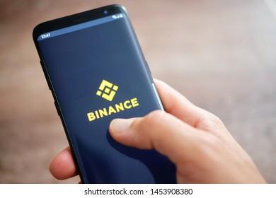 Tyumen, Russia - JULY 18, 2019: Binance mobile app running on smartphone. Binance is a finance exchange market.