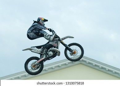 Tyumen, Russia - June 10, 2009: Stunt rider from the X-fighter team pulls upside down stunt for the watching public