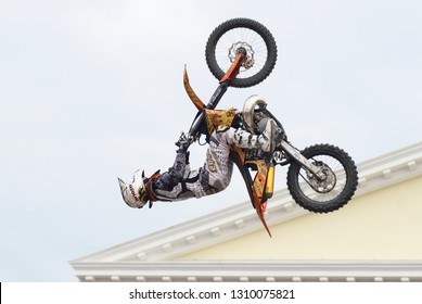 Tyumen, Russia - June 10, 2009: Stunt rider from the X-fighter team pulls air stunt for the watching public