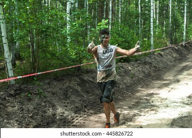 Tyumen, Russia - June 11, 2016: Race of Heroes project on the ground of the highest military and engineering school. Sportsman run between stages