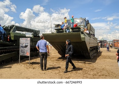 Tyumen, Russia - June 21, 2017: Army Games. Audience is photographed on tracked amphibious carrier PTS-4 with truck on board