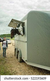 Tyumen, Russia - June 25, 2016: The 5th open championship of Russia on a plowed land. People load horses into van for transportation