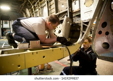 Tyumen, Russia - June 5, 2019: Aircraft repair helicopter UTair Engineering plant. Workers maintaining a Mi-8 helicopter