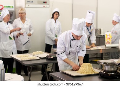 Tyumen, Russia - March 23, 2016: Open championship of professional skill among youth. World skills Russia Tyumen - 2016. Cooks prepare food in competition of masters of cook business