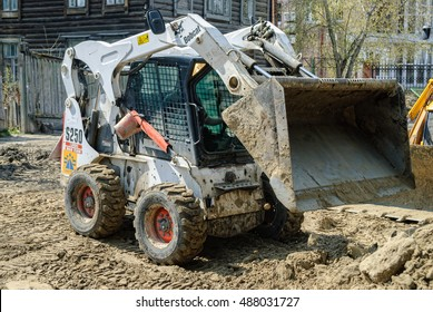 Tyumen, Russia - May 5, 2007: skid loader working on road construction