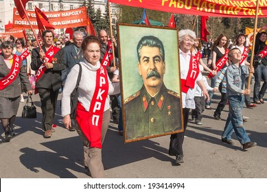 Tyumen, Russia - May 9. 2009: Parade of Victory Day in Tyumen. Members of Commubist Party of Russian Federation with Stalin's portrait on parade
